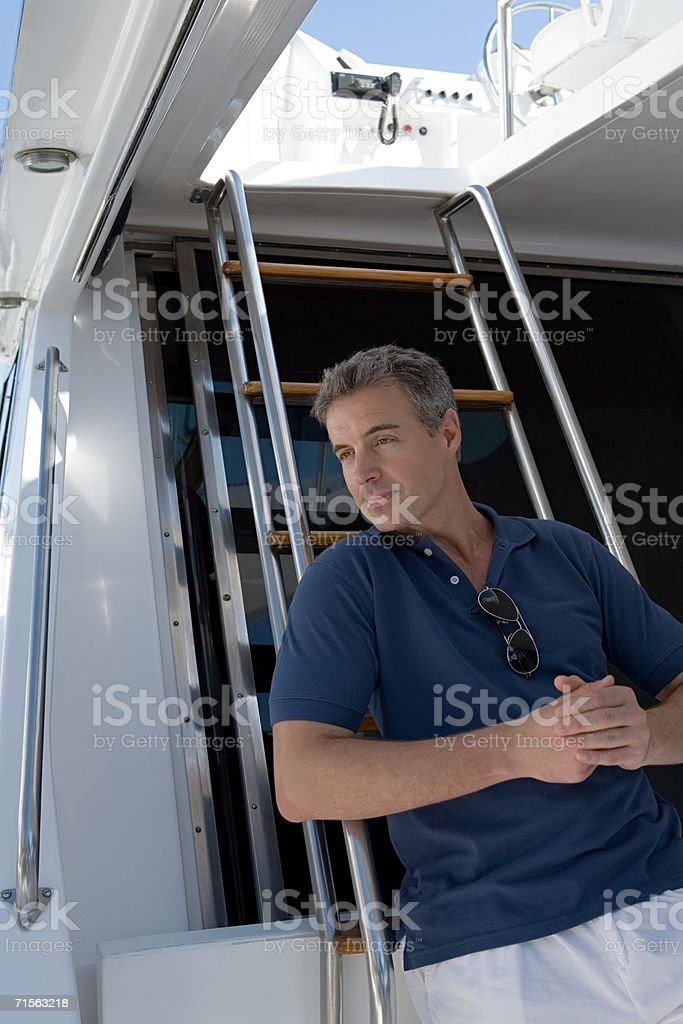Man on a yacht royalty-free stock photo