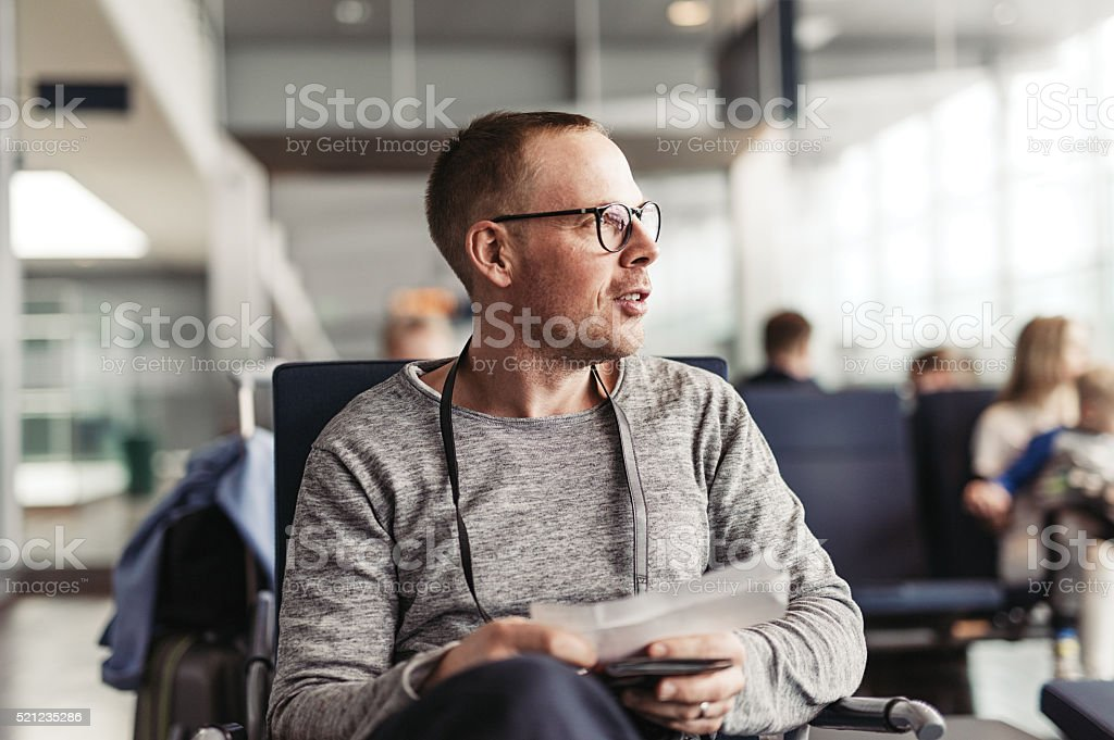 Man on airport ready to board stock photo