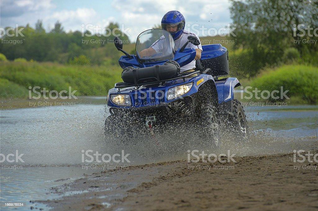 Man on ATV stock photo