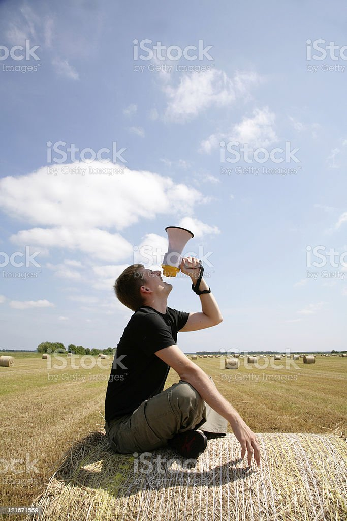 man on bale with loudspeaker royalty-free stock photo