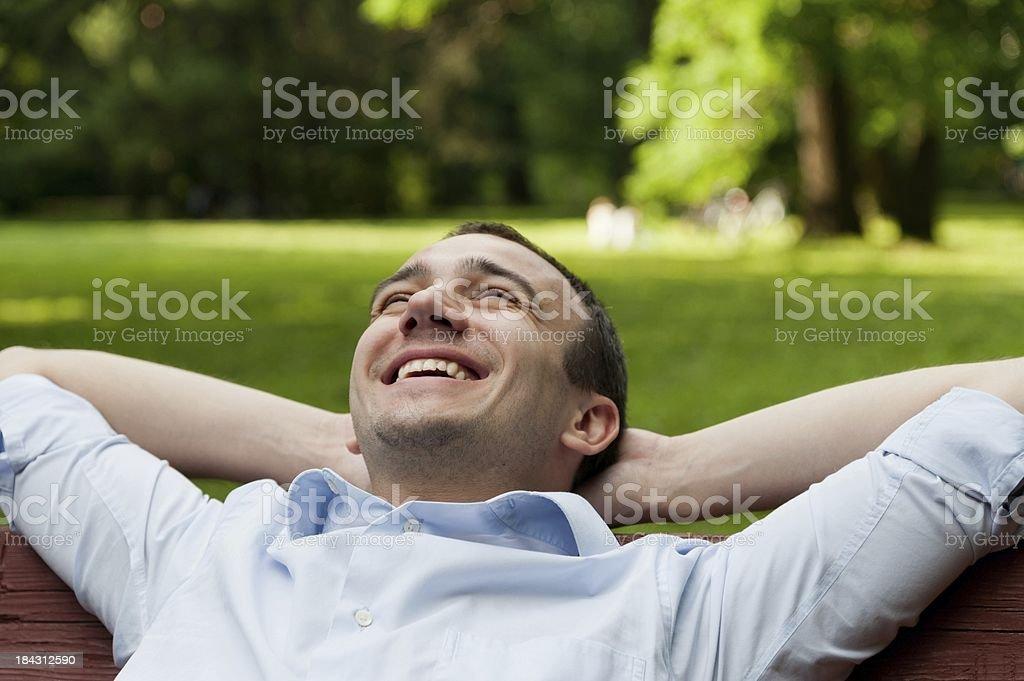 Man on bench stock photo