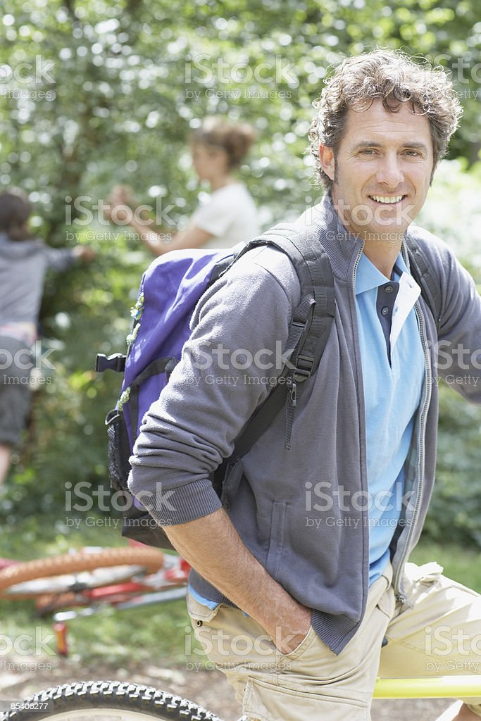 Man on bicycle in park royalty-free stock photo
