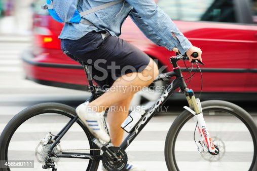 863454090 istock photo Man on bicycle in profile 458580111