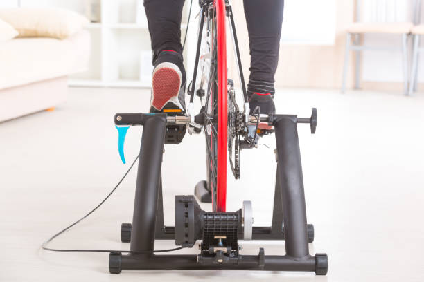 Man on bicycle trainer - Photo