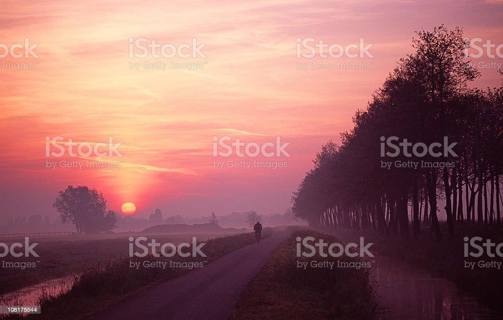 Man on bike during sunset. royalty-free stock photo