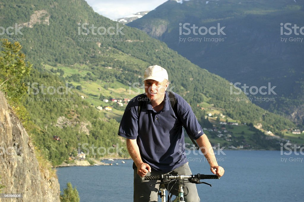 Man on bike in the mountains royalty-free stock photo