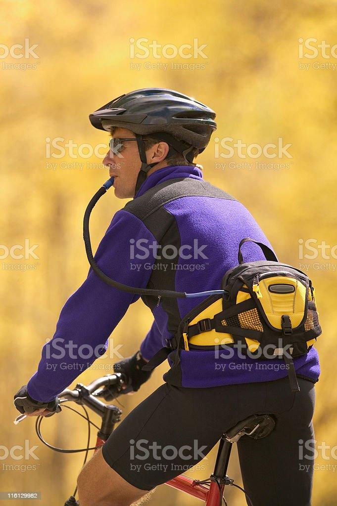 Man on Bike Taking a Break royalty-free stock photo