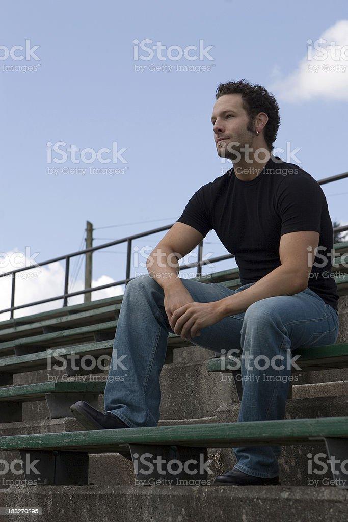 Man on Bleachers royalty-free stock photo