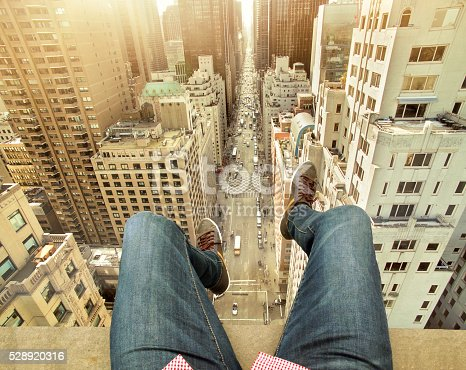 istock Man On Building Terrace Above New York City 528920316