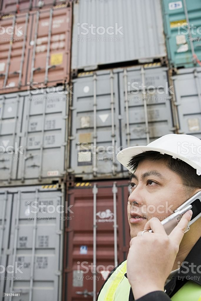 Man on cellphone at container terminal royalty-free stock photo