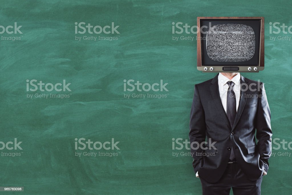 TV man on chalkboard background with copyspace - Royalty-free Adult Stock Photo