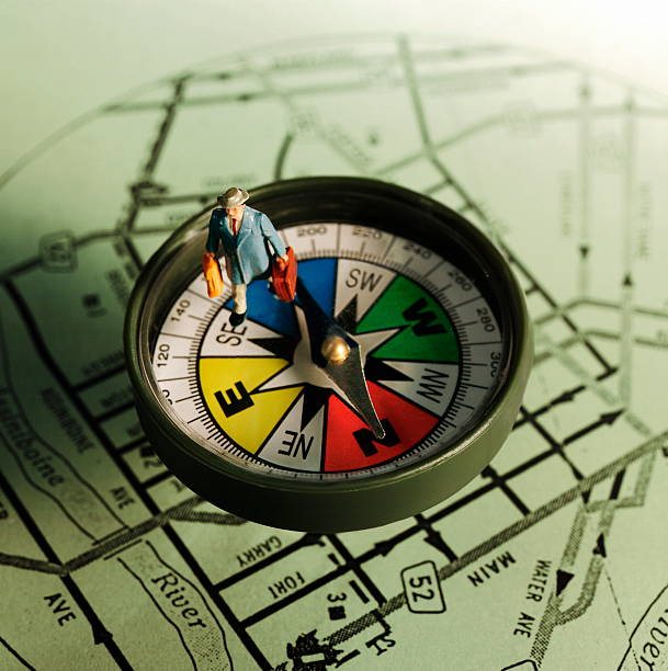 Man on Compass stock photo