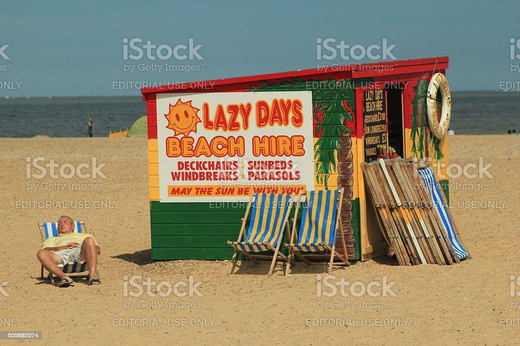 Man on Deckchair stock photo