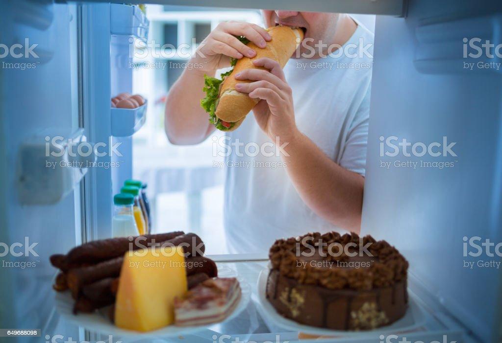 Man on diet break diet and take big sandwich stock photo