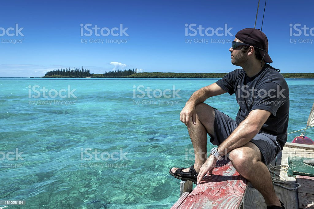 Man on Dugout Canoe, Isle of Pines, New caledonia royalty-free stock photo