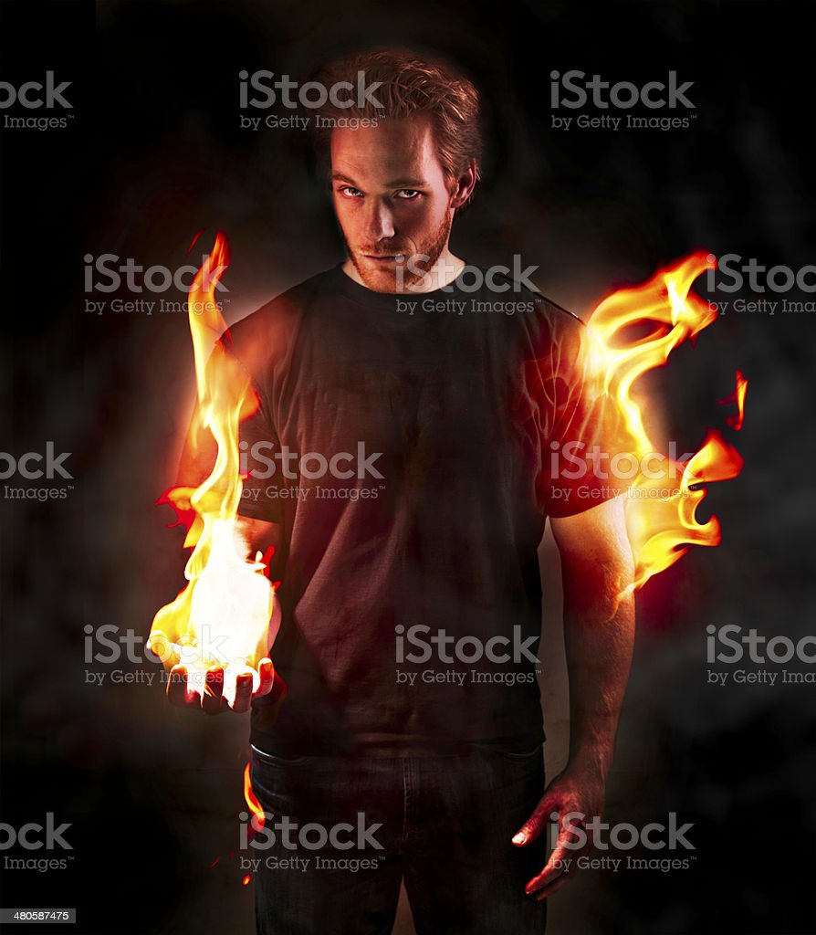 Man on fire stock photo