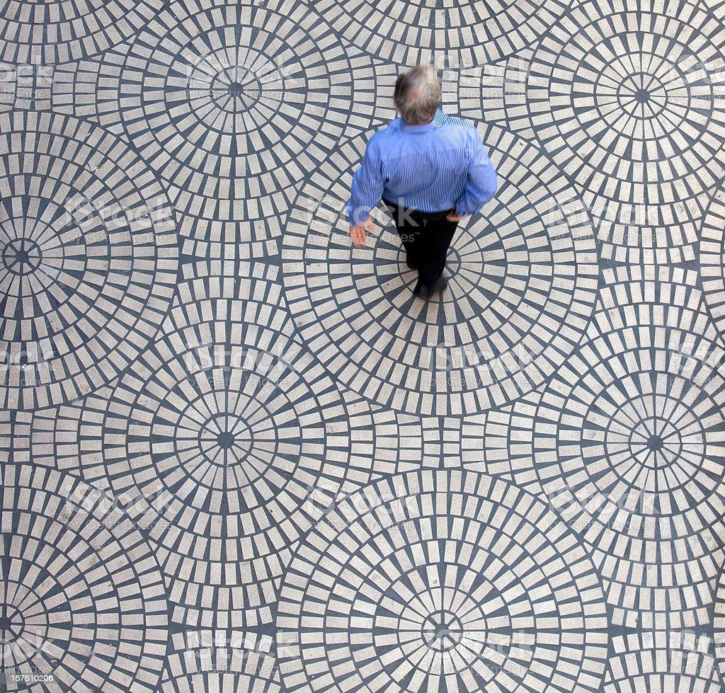 Man on geometric tiles royalty-free stock photo