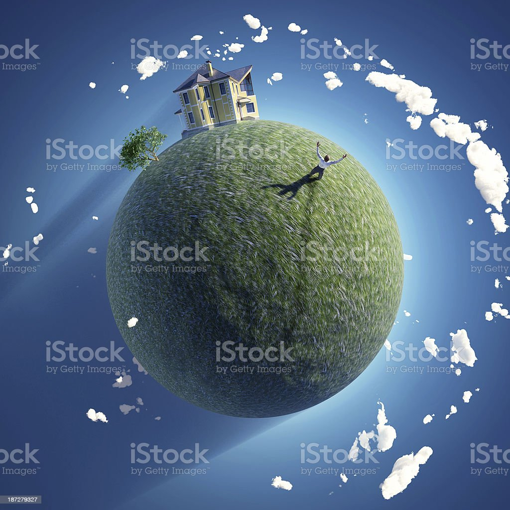 man on green planet stock photo