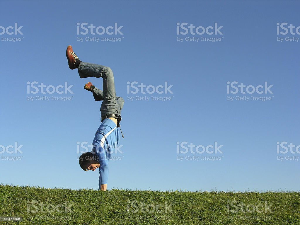 man on hands on blue sky royalty-free stock photo
