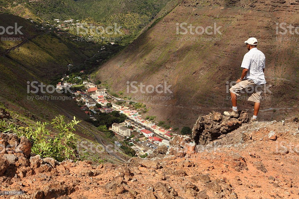 Man on hike in hills above Jamestown St Helena Island stock photo