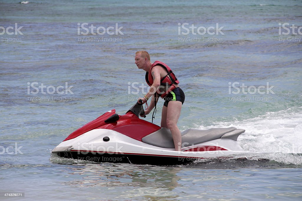 man on jet ski stock photo