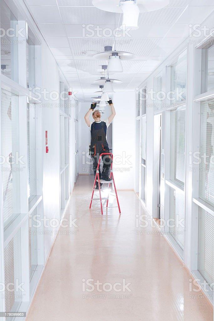 Man on Ladder stock photo
