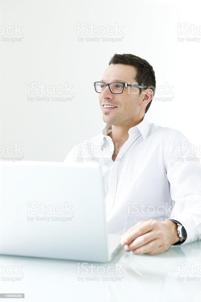 Man on laptop smiling. royalty-free stock photo