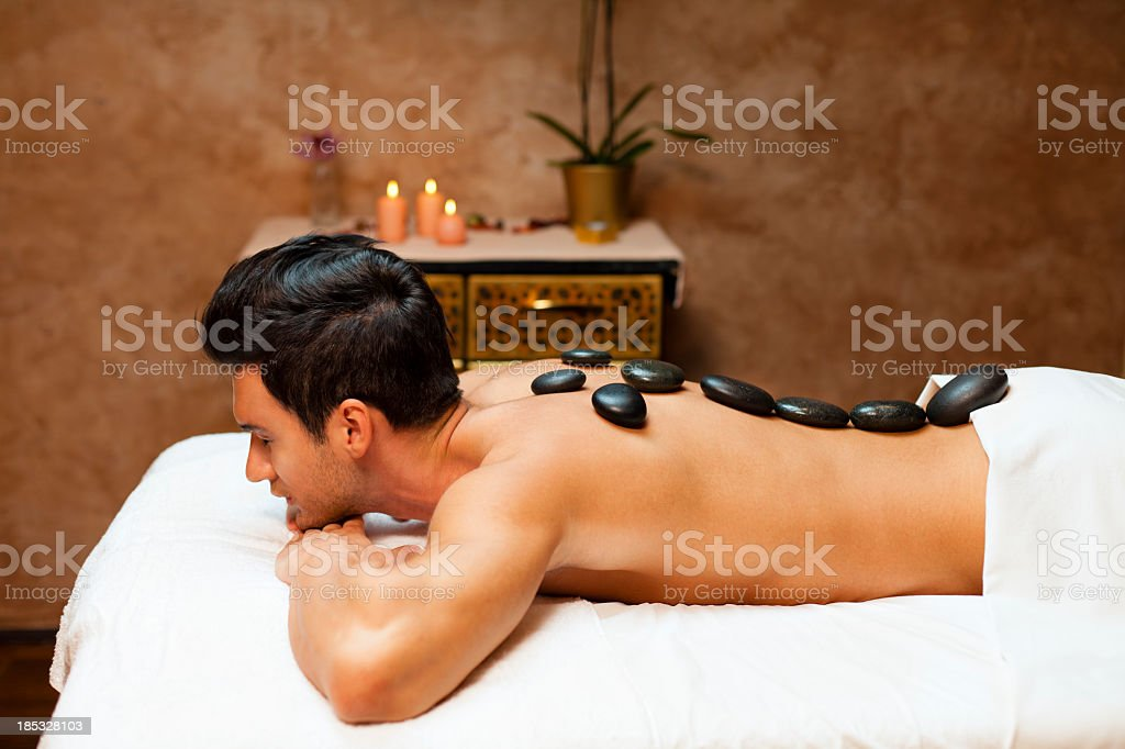 Man on lastone therapy stock photo