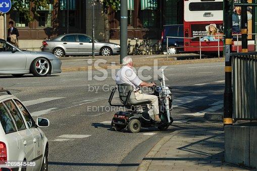 stockholm sweden 24-august - 2005   Man on motorized chair in stockholm city . on tegelbacken street,