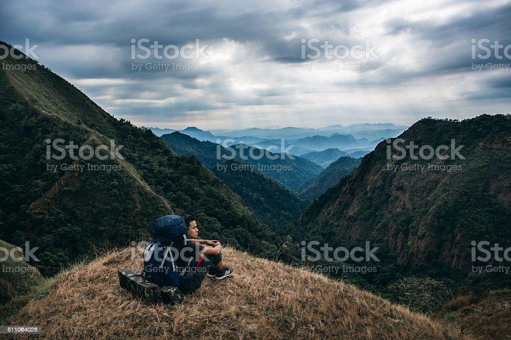 Man on mountain stock photo