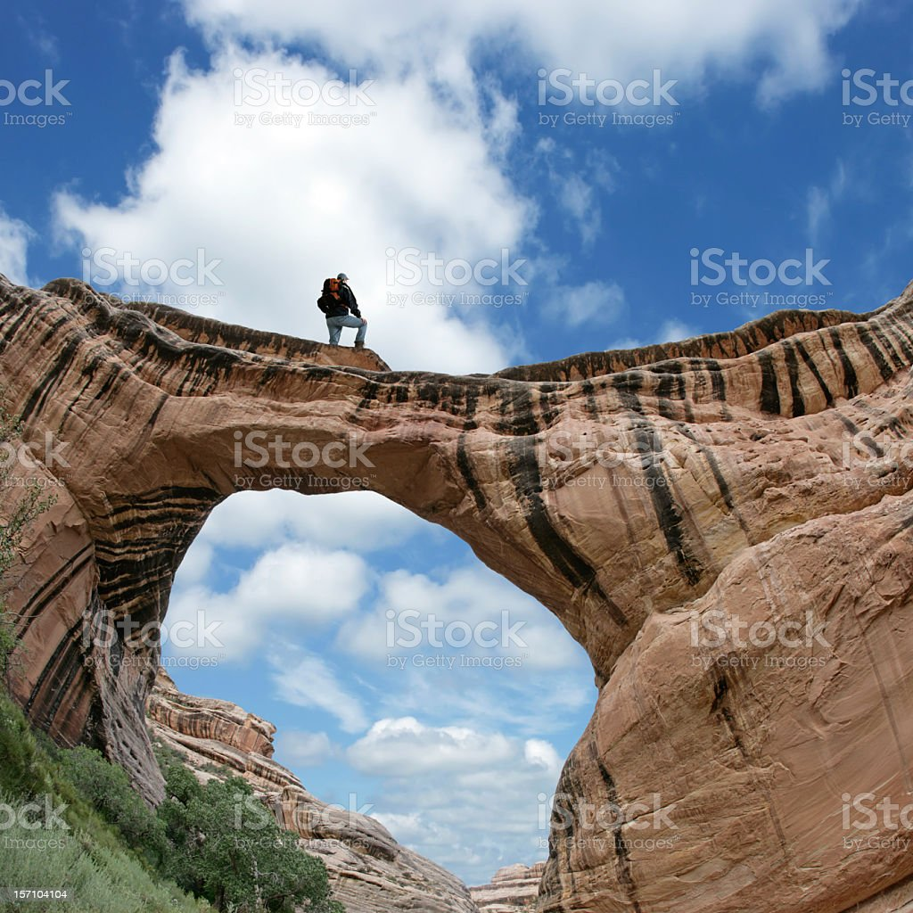XL man on natural arch royalty-free stock photo