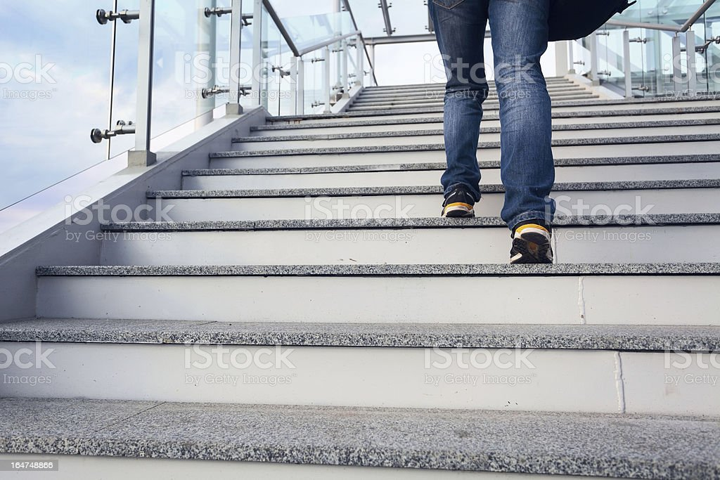 man on office stairs stock photo