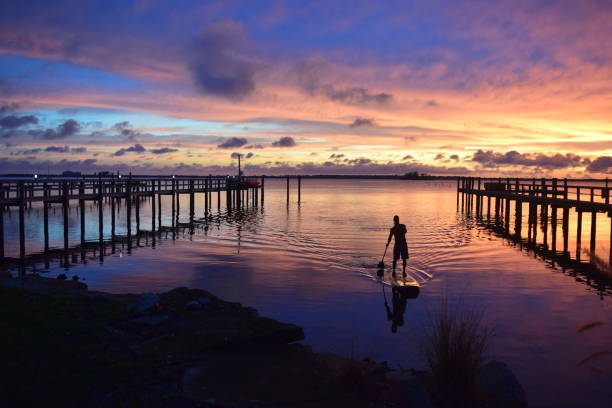 Man on Paddle board at Sunset stock photo