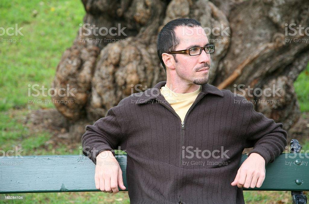 Man on park bench royalty-free stock photo