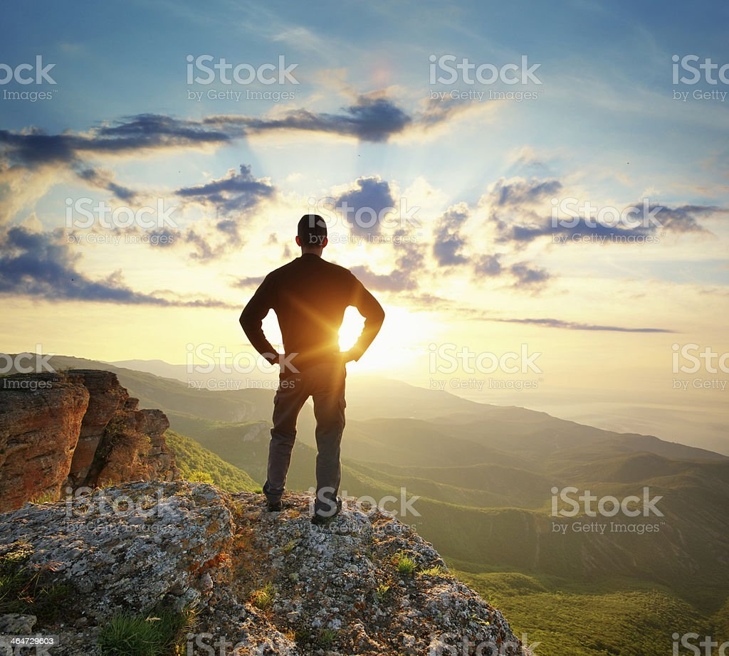 Man on peak stock photo