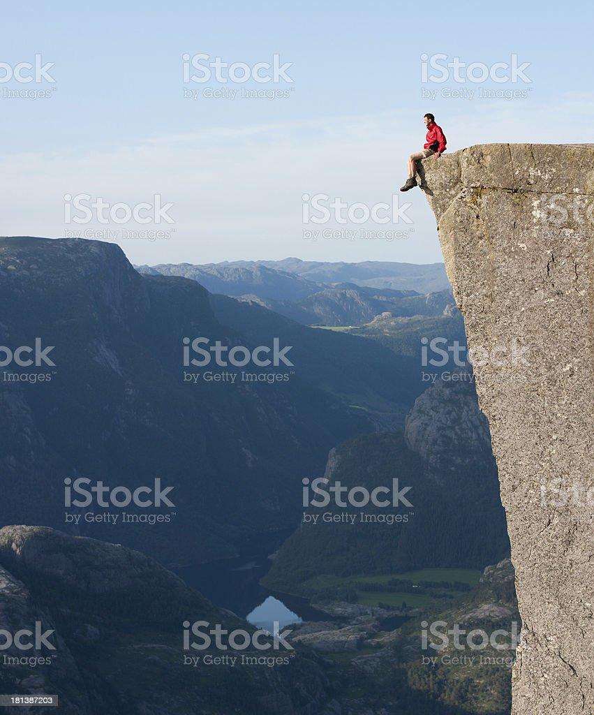 Man on Preikestolen or Pulpit rock (Norway) stock photo