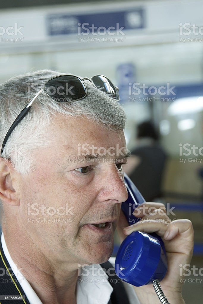 Man on public payphone royalty-free stock photo