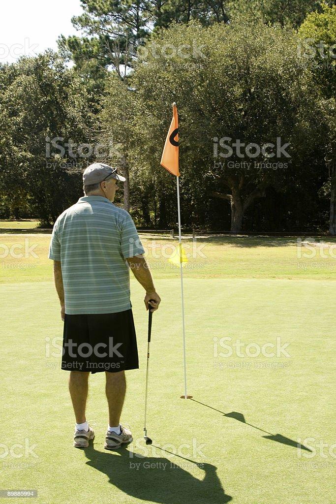 Man on putting green royalty-free stock photo