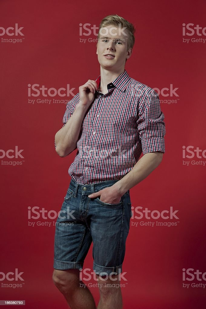 man on red background stock photo