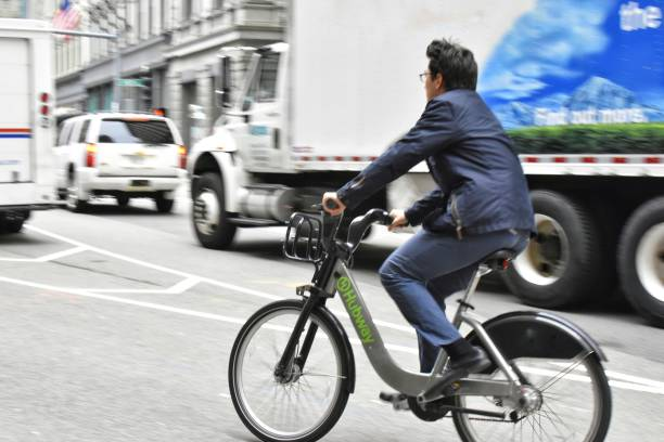 Man on Rented Bicycle in Boston stock photo
