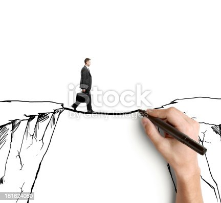 istock man on rock 181624080