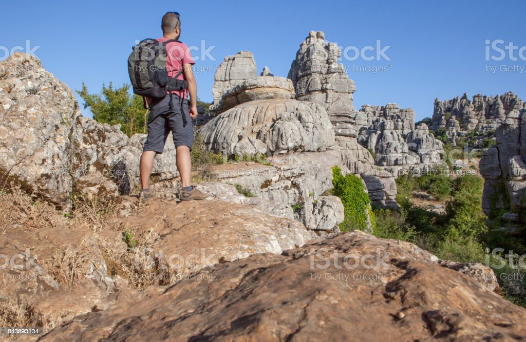 Man on rocky hill at Torcal de Antequera, Spain stock photo