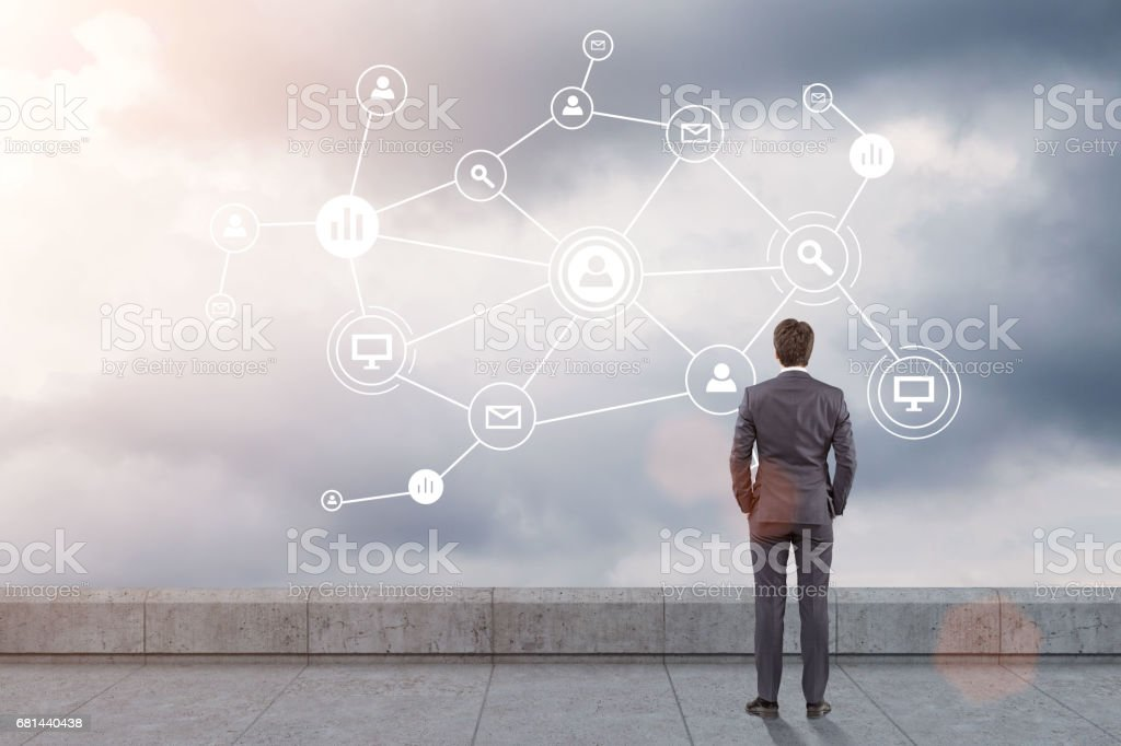 Man on roof looking at network in sky royalty-free stock photo
