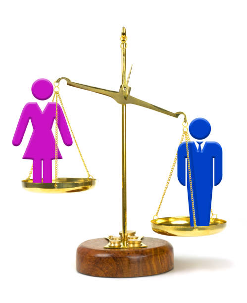 Man on scale outweighing woman representing inequality in pay and opportunities stock photo