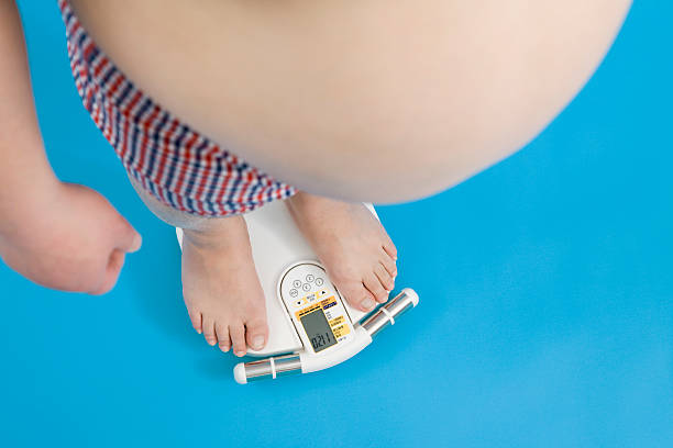 man on scale - metabolic syndrome stock photos and pictures
