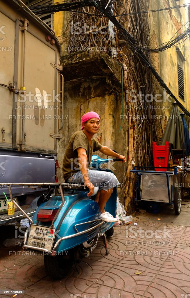 Man on Scooter, Bangkok, Thailand stock photo