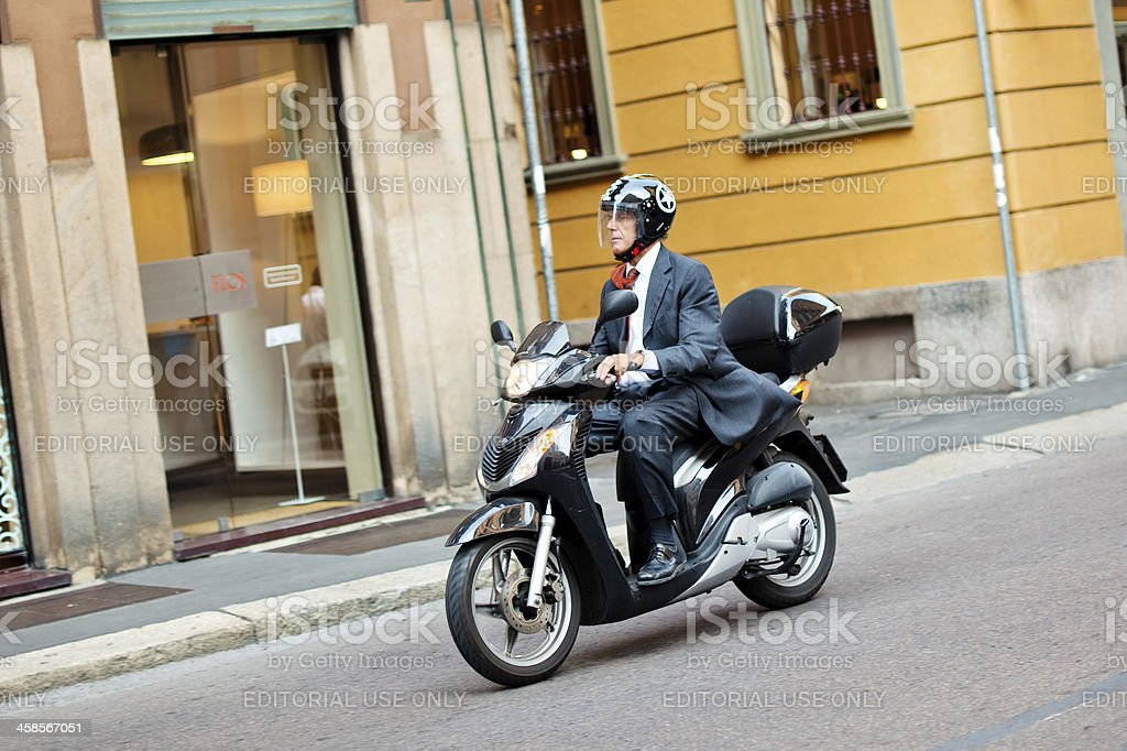 Man on scooter in Milan royalty-free stock photo