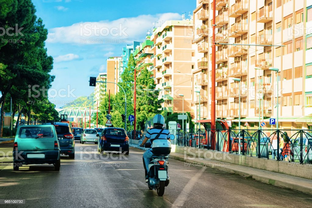 Man on scooter street of Palermo Sicily Europe zbiór zdjęć royalty-free