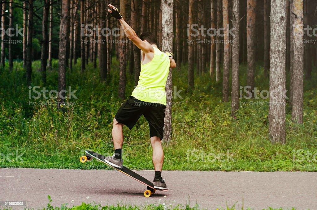 Man on skateboard (longboard) stock photo