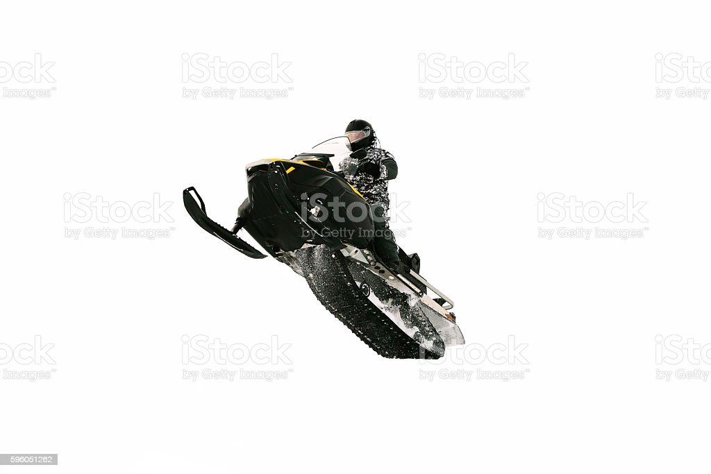 Man on snowmobile. Isolated on white background. stock photo